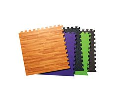 "Waterproof, vinyl tiles ($6 each; MyGymFloor.com) come in a range of colors and patterns. Click 'em together to fill any space. Each square-foot tile has hundreds of support ""legs"" for serious impact absorption. #workoutspace #fitnessstudio"