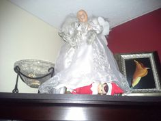 Day 18 - Reminds me of Splash when a young John Candy is peeking up the ladies skirts on the ferry... Peek a Boo Sacrilegous elf under an angel. So classy up in my house.