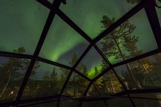 The Northern Lights over Kakslauttanen in Autumn. The view from the iconic Glass Igloo.