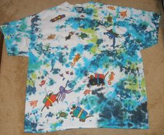 I decorated this shirt with tie dyes and then fabric pens.  Scuba Diving Dachshund Wiener Dogs Tie Dye T by SassySashadoxie, $20.00