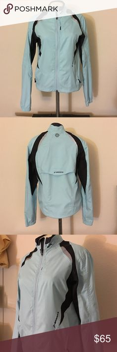 Brooks lightweight jacket In good used condition No flaws Jacket is ideal for running, hiking and biking Women's Size Small Drawstring Hem Cord Drop Tail Hem  Lightweight and breathable  Ventilation in the back  Reflectors on front and back Orig $90 Brooks Jackets & Coats