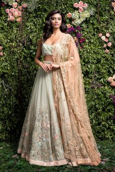A subtle green lehenga with embroidery done in contrasting thread ,zari ,glass pipes and sequence.The dusty pink tulle dupatta has delicate pita embroidery all around and motifs scatter inside.The lehenga is finished with shimmer sequence edge. Bridal Lehenga Choli, Indian Lehenga, Red Lehenga, Anarkali, Indian Wedding Outfits, Bridal Outfits, Indian Outfits, Wedding Lehenga Designs, Shyamal And Bhumika