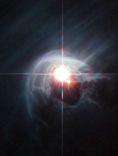 AVANCES: SMOKE RING FOR A HALO  Two stars shine through the...