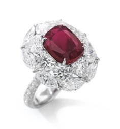 'The Emperor Ruby' Very important ruby and diamond ring Set with a cushion-shaped ruby weighing 7.03 carats, accented with heart- and marquise-shaped diamonds, the mount further set with brilliant-cut stones, size 51.