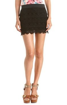 Tuck just about any top into this super sweet scalloped mini skirt for a simple and girly vibe.