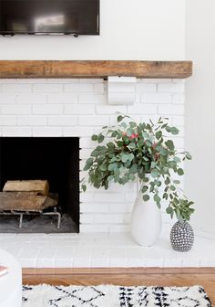 Modern Rustic Painted Brick Fireplaces Inspirations - Decorating Ideas - Home Decor Ideas and Tips Decor scheme - white, brick (natural or white but not gray), and wood White Fireplace, Fireplace Mantels, Mantel Shelf, Wood Fireplace, Mantles, Fireplace Modern, Fireplace Design, Reclaimed Wood Mantle, Fireplace Ideas
