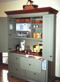 Armoire Hospitality Centers & Working Pantries | YesterTec Kitchen Design Company - Isn't this just grand? Storage and beauty in one package is hard to beat! This would be great in a cabin kitchen - and I could hide away the little electric goodies that don't go with the rustic look!! Perfect coffee bar!