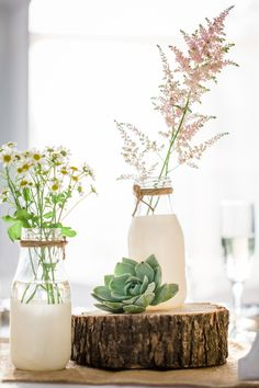 DIY Milk Bottle Centerpieces with Wildflowers milk bottle crafts painted vases DIY Milk Bottle Centerpieces with Wildflowers Milk Bottle Centerpiece, Jar Centerpieces, Bottle Vase, Wedding Centerpieces, Wedding Decorations, Wedding Ideas, Diy Wedding, Wildflower Centerpieces, Wedding Arrangements