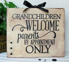 Holly Gagnon of Ribbons and Glue creates a handmade wooden sign for Grandparents using the Silhouette and Buttons Galore. #buttons