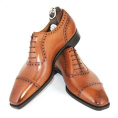 Gotta have some brown shiny leathers. At least 3 different shades. Gaziano Girling
