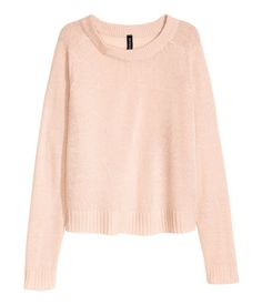 Powder pink. Knit sweater in soft fabric with ribbing at neckline, cuffs, and hem. Slits at sides.