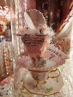 stacked tea cups under glass dome