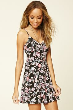 A knit floral print dress with dual cami straps that crisscross at the back and a V-neckline.
