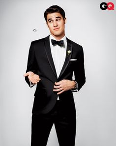 Darren Criss :) He is supposed to be straight from what I hear but even if he's not he's still super sexy! Favorite guy on Glee next to Mr. Shue of course!