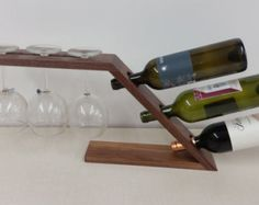 Here is a unique way to display a nice bottle of wine or champagne along with a nice pair of glasses. This will look great on your counter top, bar or table.    Made of Curly Cherry Wood and Black Walnut.    Dimensions,  About 20 long  6 wide  This piece has a hand rubbed oil finish.    Wine bottle and glassed not included.    This would make a great Wedding, Anniversary or House Warming gift.  Or a great gift for all the Wine lovers out there    .