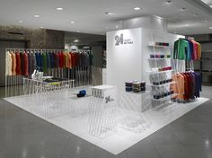 Japanese designers Nendo have completed a store in Tokyo for fashion designer Issey Miyake. Called 24 Issey Miyake, the shop is inspired by Japanese convenience stores. Each design is available in twenty colours and the store will completely change its stock every two months. There are no stock rooms and garments are displayed on white