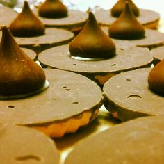 Witches hat cupcake toppers! Fudge round cookies, icing, and Hershey kisses! :)