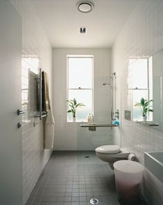 The bathroom's width and reinforced handrails accommodate Wansbrough's needs.