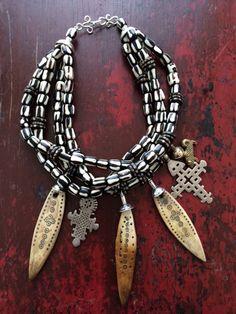 New batik bone beads, antique bone amulets, old silver Coptic crosses.
