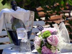 Loving cup goblet and fizz. Alongside the Brides bouquet. Photograph by Cherry Thatcher.