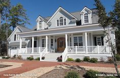 Home Plan The Santee# Columns and dormers accent a deep porch, while gables and half-circle transoms add architectural interest. Bay windows expand space and usher light into the home. Convenient features such as a central kitchen island, utili Style At Home, Country Style House Plans, Country Style Homes, Southern House Plans, Southern Homes, Coastal Homes, Southern Style, Luxury House Plans, Dream House Plans
