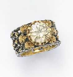 Buccelatti. Lisa, you really must top pinning these fabulous rings!!!:)