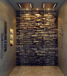 Stone wall and multiple shower heads