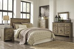 Replicated oak grain takes the look of rustic reclaimed wood on this panel bed. The metal brackets at the corners of the headboard and footboard even feature a rivet look for an industrial design detail. In any bedroom, this bed has great modern farmhouse character for any space.