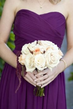 Deep purple gown with creamy ivory blooms