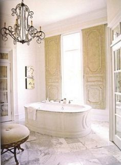 Beautiful Antique sliding doors .. such a beautiful bathroom....& glass doors opeing onto a private balcony.