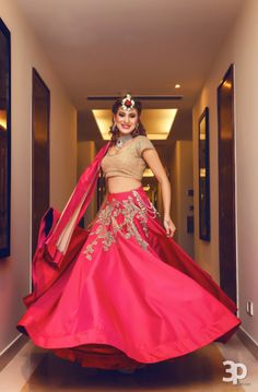Light Lehengas - Bride in a Red Lehenga with a Gold Choli and Embroidered Top Half of the Skirt | WedMeGood | Photo by: Perfect Pixels Production #wedmegood #indianbride #indianwedding #lightlehenga #red #gold #lehenga #bridal