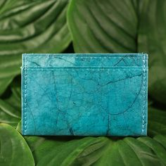 Unique, stylish and super light handmade cardholder, beautifully made from  Teak Leaves in the Lampang province, northern Thailand. Using  environmentally friendly materials and manufacturing processes, such as  vegetable dyes and sun drying, these products are 100% waterproof and  completely leather free. Each design is unique and fits standard size cards  and business card.  Available in yellow, blue and red size: 11 cm x 7 cm