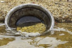 The old traditional method of panning for gold in streams and rivers and different places of Australia in the gold rush times, some places were Bendigo, Ballarat in victoria, Australia. People still pan for gold now and the odd nugget is still found.