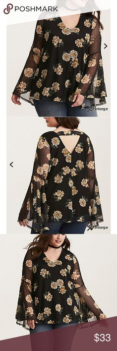 Torrid floral print mesh Bell sleeve top We're drama queens; can't you tell by this top? Did the totally sheer black mesh that's been detailed with a look-at-me faded yellow floral print tip you off? Did the exaggerated bell sleeves that were made for twirling give you a hint? What about the v neck and back strap? Torrid size 3 Torrid Tops Blouses