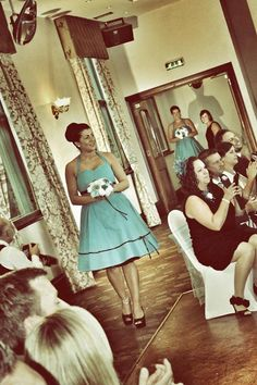 Bridesmaid with flower & brooch bouquet