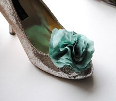 Silver heels with blue flower clip.