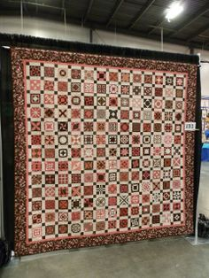 """Birthday Jane"" by Kerry Marksbury, San Diego, CA.  ""My journey with Jane started in April 2011 with 25 of the blocks given to me by quilting friends for my 50th birthday.  In April 2011, I met Brenda and attended her class at Asilomar.  It was completed in March 2013, in time for a third trip to Brenda's class."""