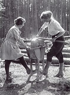Women's Forestry Corps, UK 1918. Land Girls or Lumberjills, they got it done and dressed like ladies too. Heeled boots and white Lacey blouse look less comfy than denim and boots.
