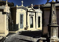 """The Cemetery of Prazeres (""""Pleasures"""", odd name for a cemetery, but comes from the nearby neighborhood of Prazeres), started out like the noted cemeteries of Porto.  It was originally created to handle the thousands of victims of the cholera epidemic in 1833-34.  By 1839, wealthier families began to build monuments.  Several hundred tombs were build between 1839 and1850 alone.  Many important names figures of Portuguese arts and politics are buried here."""