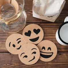Or communicate your mood to your coworkers by swapping out emoji coasters. | 22 Products That Will Make The Office Your Happy Place