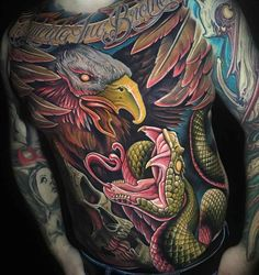 eagle vs snake tattoo on torso