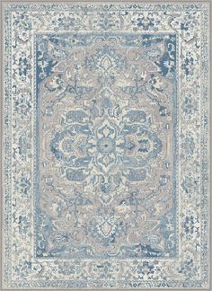 Honor any room with this intricate Persian-inspired traditional area rug. The filigree design and contrasting border are distressed to give a time-worn and dignified appearance. In dove gray, indigo, light blue, buff and creamy ivory. Machine-made...