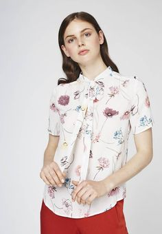 """Blouse - white alyssum. Sheer:semi-sheer. Outer fabric material:100% polyester. Total length:23.5 """" (Size 8). Collar:Mandarin collar. Back width:14.0 """" (Size 8). Length:standard. Pattern:floral. Fit:regular. Neckline:Low V-neck. Our model's height:Our model is 71.0 """" tal..."""