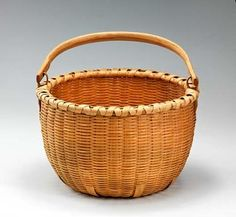 Medium Apple Basket    2010 Jamin Uticone Born: Seneca Falls, New York 1975 black ash 13 1/4 x 14 in. (33.7 x 35.6 cm) diam. Smithsonian American Art Museum Gift of Martha G. Ware and Steven R. Cole