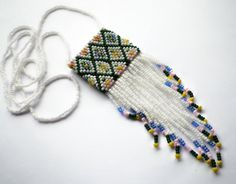 Image reminds me...I bought a celtic pouch kit that I need to work on...Spring Flowers- Vintage Bead Woven- Amulet Bag- Tapestry Bag- Necklace- Gift for Her via Etsy