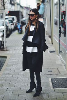 Classic black coat with stripes.