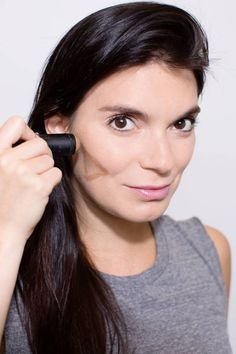 Pretend there is a triangle with the base along your cheekbone and the point toward your jawline, then buff your bronzer into your skin in that formation. This will properly place the bronzer, since that's where your cheeks naturally flush when you overheat. Just make sure to blend with a bronzer brush, so you can't see any distinct lines. (Tip courtesy of James Boehmer for Nars at Creatures of the Wind.)