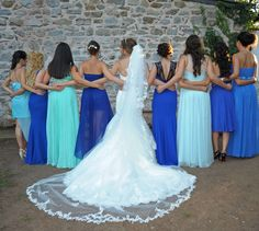 Lovely Blue & Turquoise mismatching bridesmaid dresses.. Almost like the waves of the sea <3