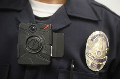 The first sign of change: Ferguson police are now wearing body cameras