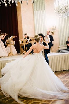 """""""Get lots of full-length options while you're dancing! The first dance is such a romantic moment, and the movement of the dress is really at its best,"""" say the pros at Mon Amie Bridal Salon."""